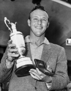 "File-This July 15, 1961, file photo shows Arnold Palmer smiling with his trophy and medal after winning the British Open Golf Championship by a single stroke at Royal Birkdale course in Birkdale, Lancashire, England. Palmer, who made golf popular for the masses with his hard-charging style, incomparable charisma and a personal touch that made him known throughout the golf world as ""The King,"" died Sunday, Sept. 25, 2016, in Pittsburgh. He was 87. (AP Photo, File)"