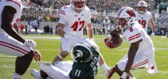 No. 11 Wisconsin routs No. 8 Michigan State 30-6